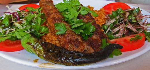 A plate of adana kebab.
