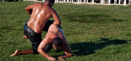 Two Turkish men oil wrestling
