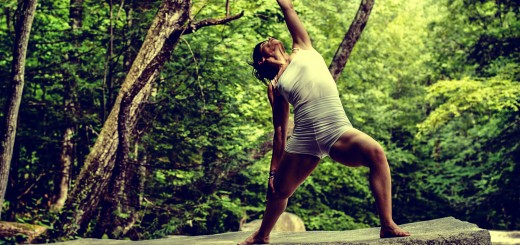 A photo of a woman practising yoga outdoors.