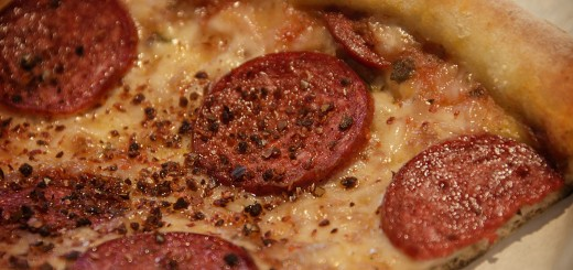 A close-up photo of a pepperoni pizza.