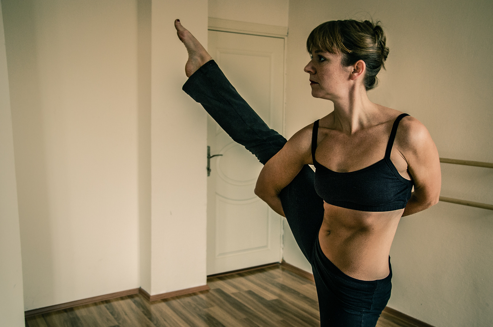 A photo of yogi and dance instructor Christina Markowski in the Bird of Paradise yoga pose.