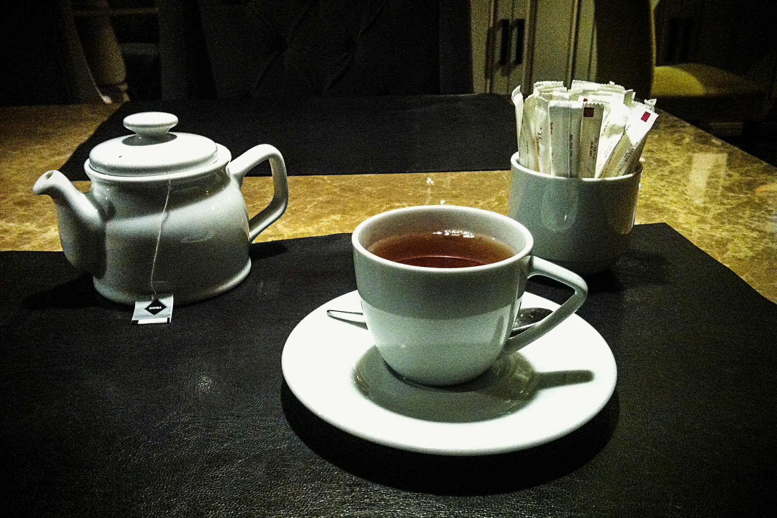 A photo of a teacup and teapot at Vanilla restaurant in Antalya.