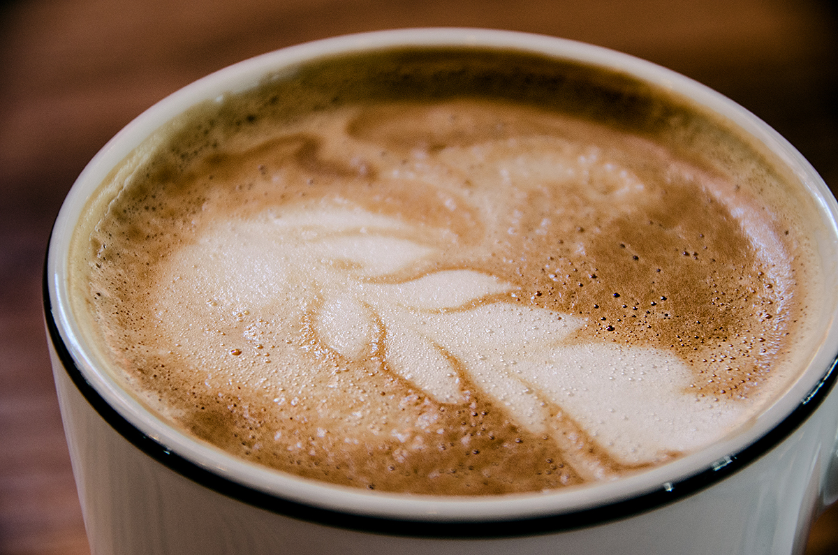 A photo of a caffè latte with latte art on top.