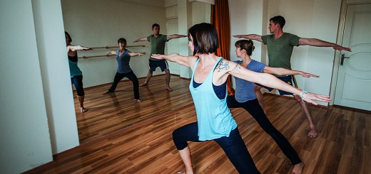 A photo of three people practising yoga at Fiery Feet Studio in Antalya.